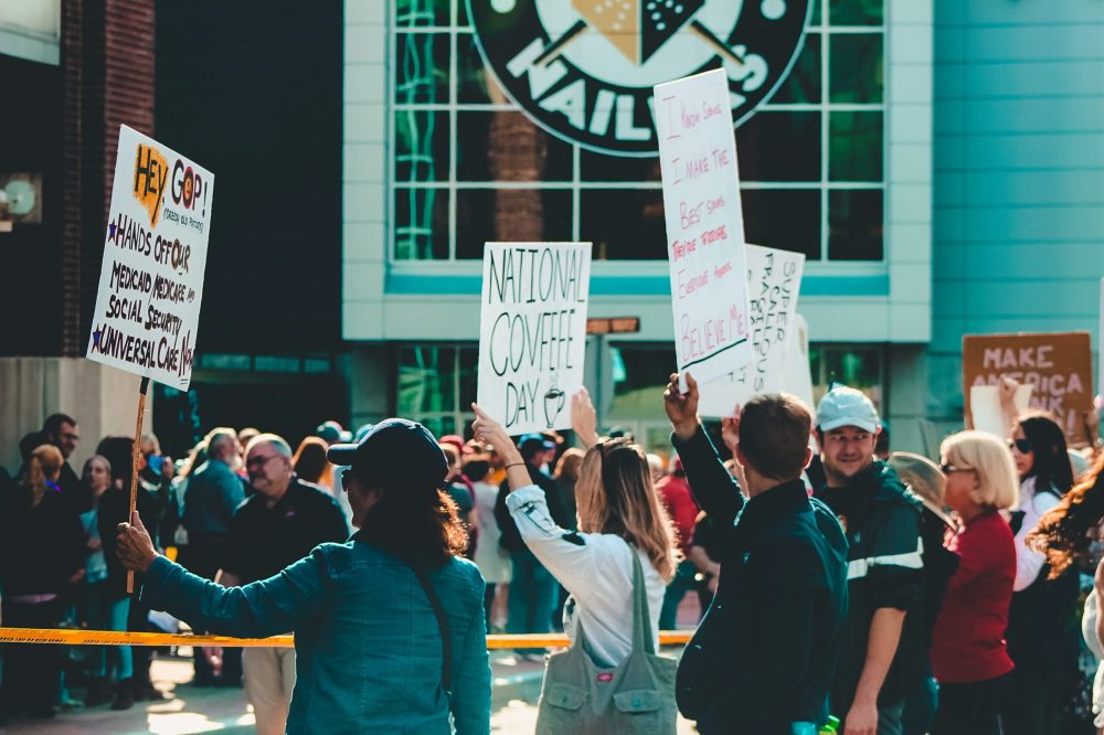 crowd-of-people-holding-signages-1464218