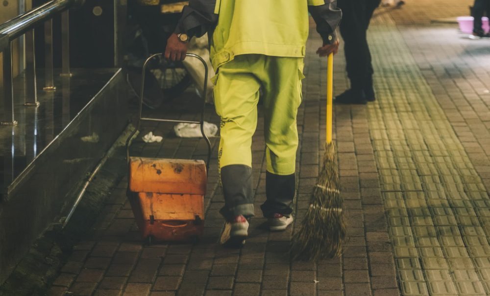 man-holding-broom-and-dust-pan-2892868