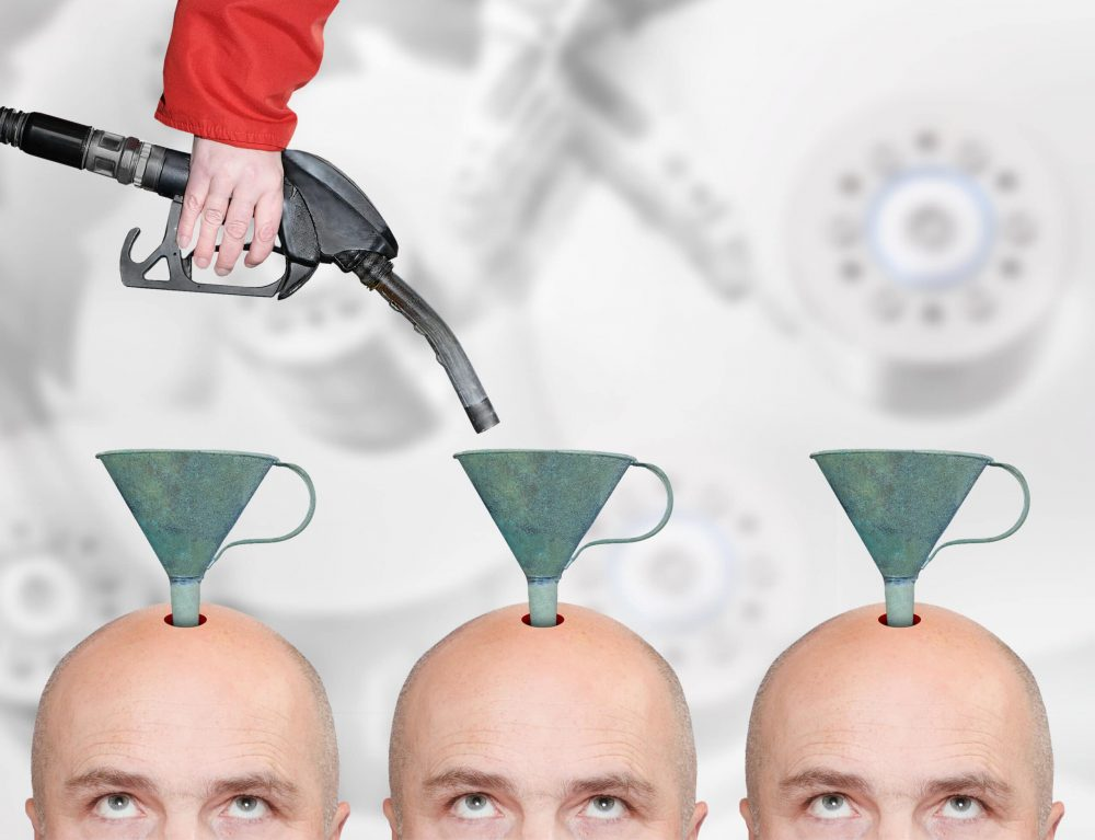 Hairless men's heads with funnels and fuel nozzle. Production line for education or brainwashing.