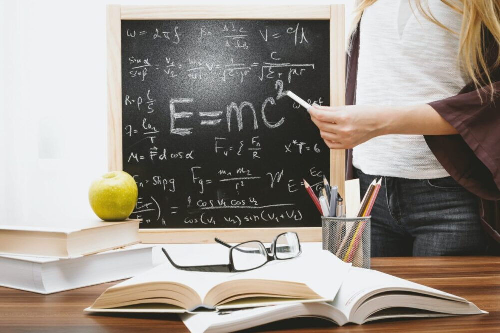 woman-illustrating-albert-einstein-formula-714698