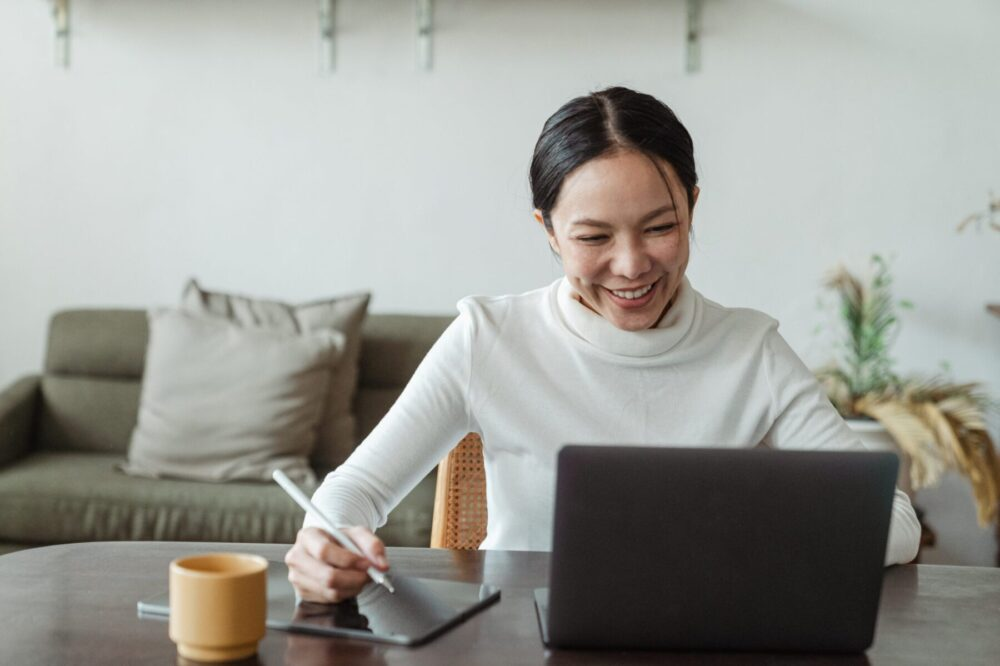 woman-working-at-home-and-making-video-call-on-laptop-4474047